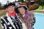 Tony and Christine Canueto dressed up for work as the Pearly King and Queen to mark their 30th wedding anniversary and three decades in business.