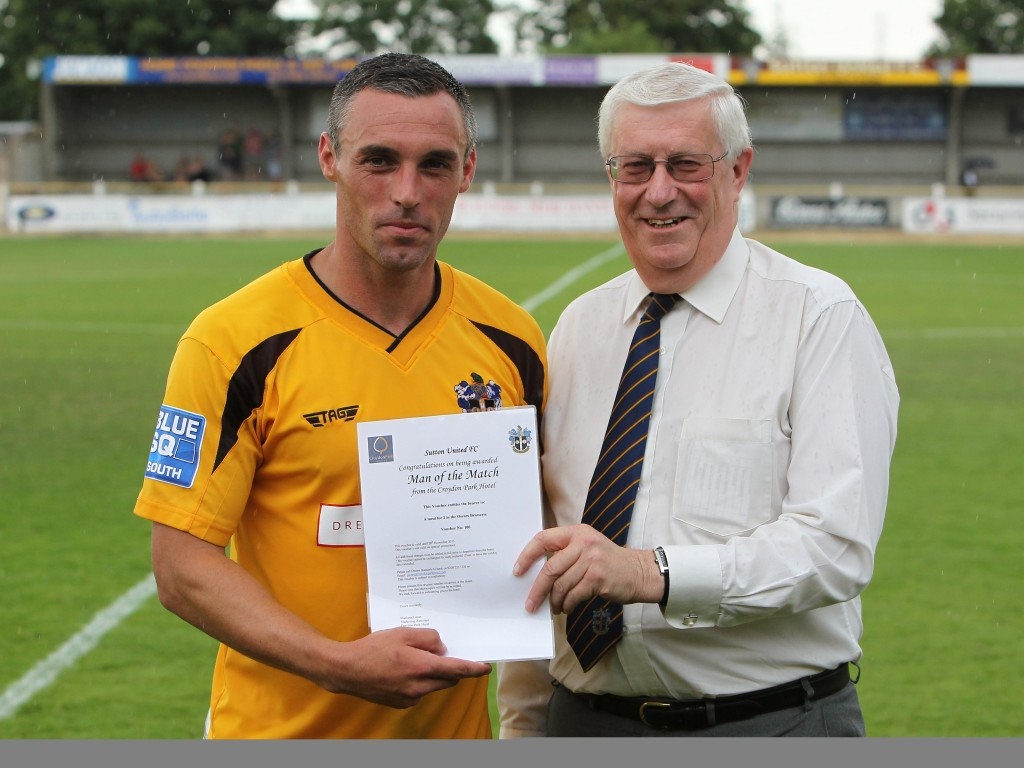 Pictured here, presenting the Player Of The Match award, David Mathers will be able to spend more time devoted to the development of Sutton United Football Club following his retirement from SCP UK.