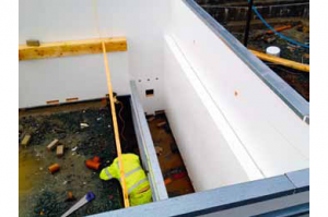 The picture features a Deck Level Panel Kit swimming pool up to 3.5m deep, with a built in Automatic cover pit.