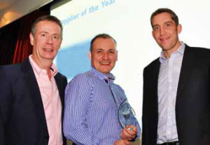 Steve Martin, centre, of Paramount Pools collects the trophy for Supplier of the Year from sponsors V12 Finance, pictured here with Stephen Parry.