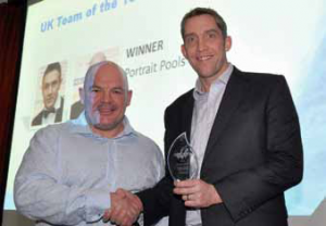 David Bland collects the trophy for 2014 UK Team of The Year on behalf of Portrait Pools & Enclosures.