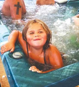 Ava Danielson and her family are enjoying the water therapy benefits of a hot tub that was donated by Lakeland Spas.