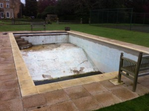 Dating back to the 1960's, this pool had been painted numerous times and had fallen into a state of disrepair. Pic: Grayfox Swimming Pools.