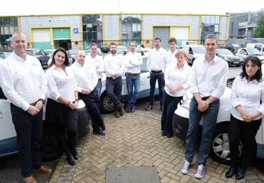 Some of the team from London Swimming Pool Company, outside their new office in New Malden