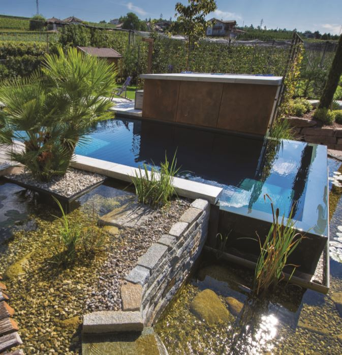 Making the most of differing ground heights, this natural pool by Milla features two small lakes placed on two levels that create a waterfall along the overflowing edge. The double-depth water level makes the pool suitable for both adults and children, while the plant room is cleverly disguised by elegant wooden decking to enhance the aesthetic appeal of the pool area. Category: Biopools. Winner: Milla.