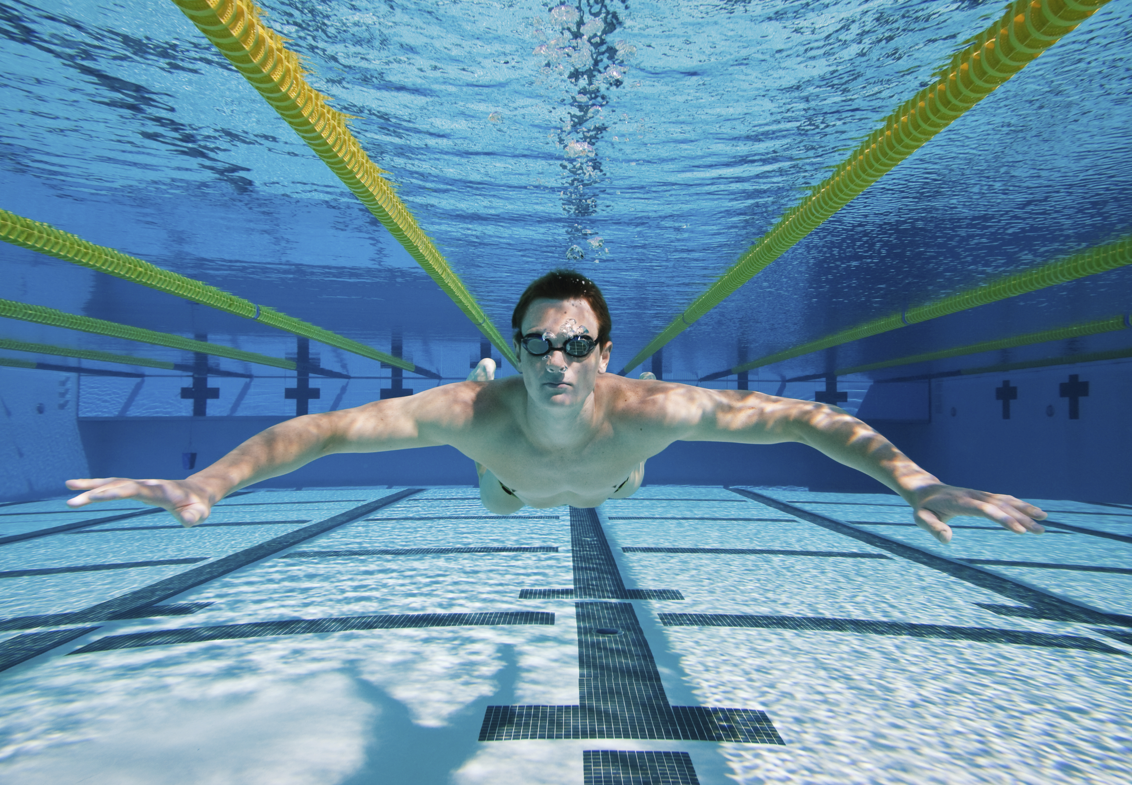 Athletic Swimmer Floating Underwater in Pool