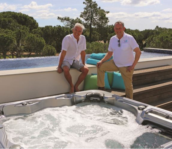 TV presenter Philip Schofield, left, is pictured with his new Artesian spa and Andy Coulton of Good Life Spas.