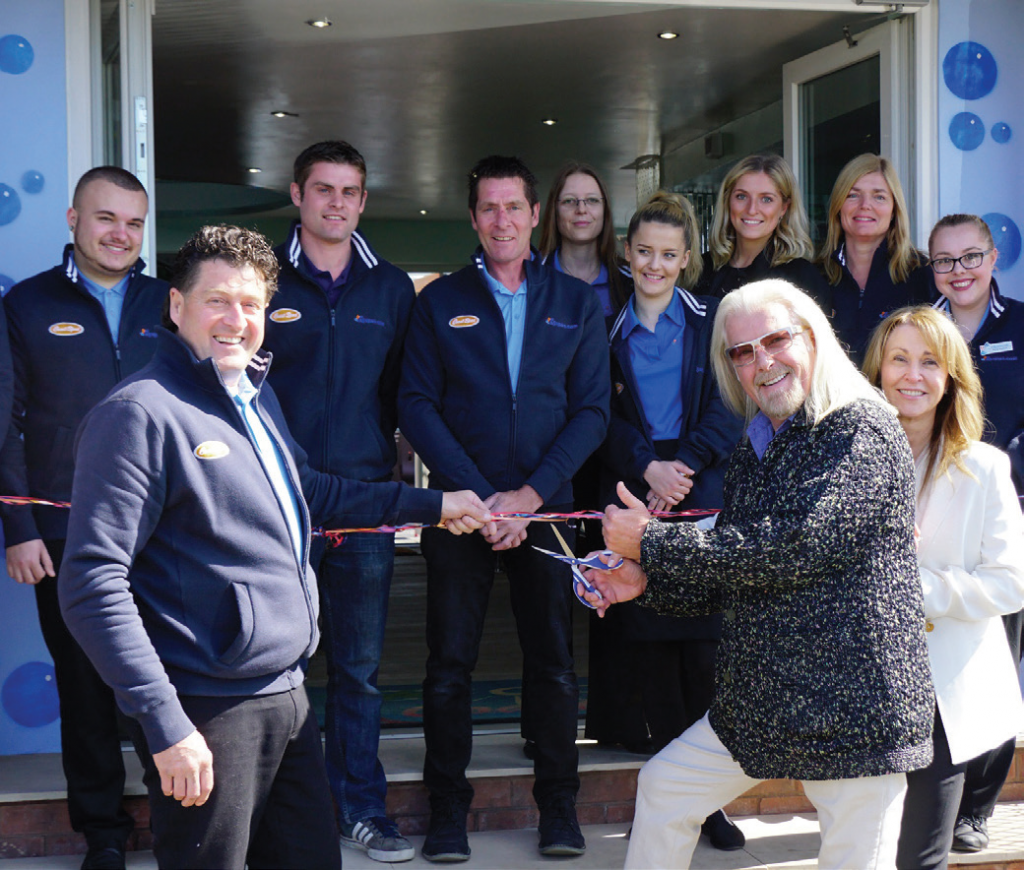 Don Elkington of Coast Spas cuts the ribbon on the new A5 Spas showroom in Warwickshire