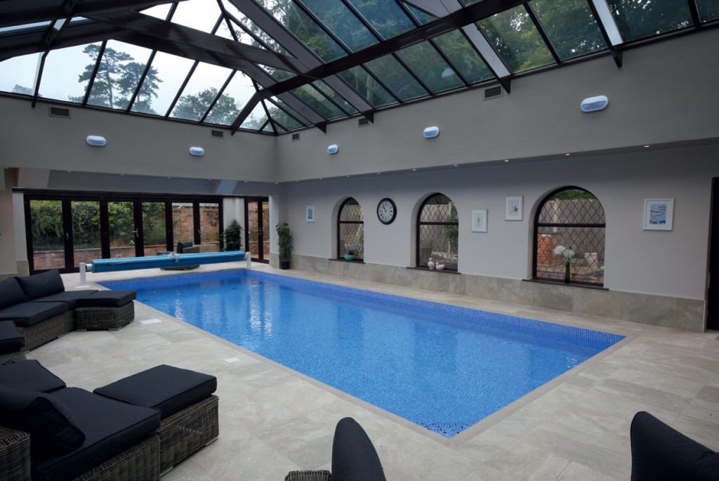 The Grayfox team re-designed the entire area to incorporate a longer pool that extends into a glass extension.