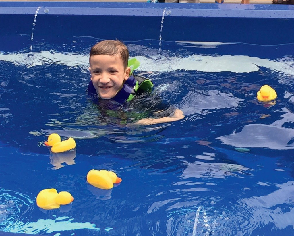 Eight-year-old Chase is enjoying his new swim spa courtesy of Make-A-Wish and Marquis Spas.