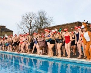 Swimmers take the plunge at Brockwell Lido in aid of homeless charity Crisis.