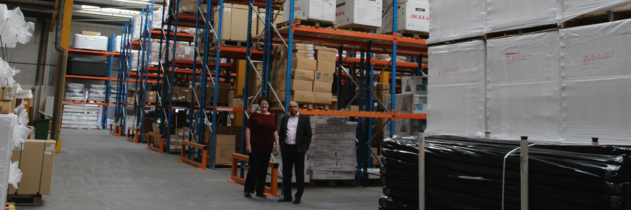 Jackie Ceesay and Dash Ganeson pictured in the vast SCP UK warehouse space available at Gatwick