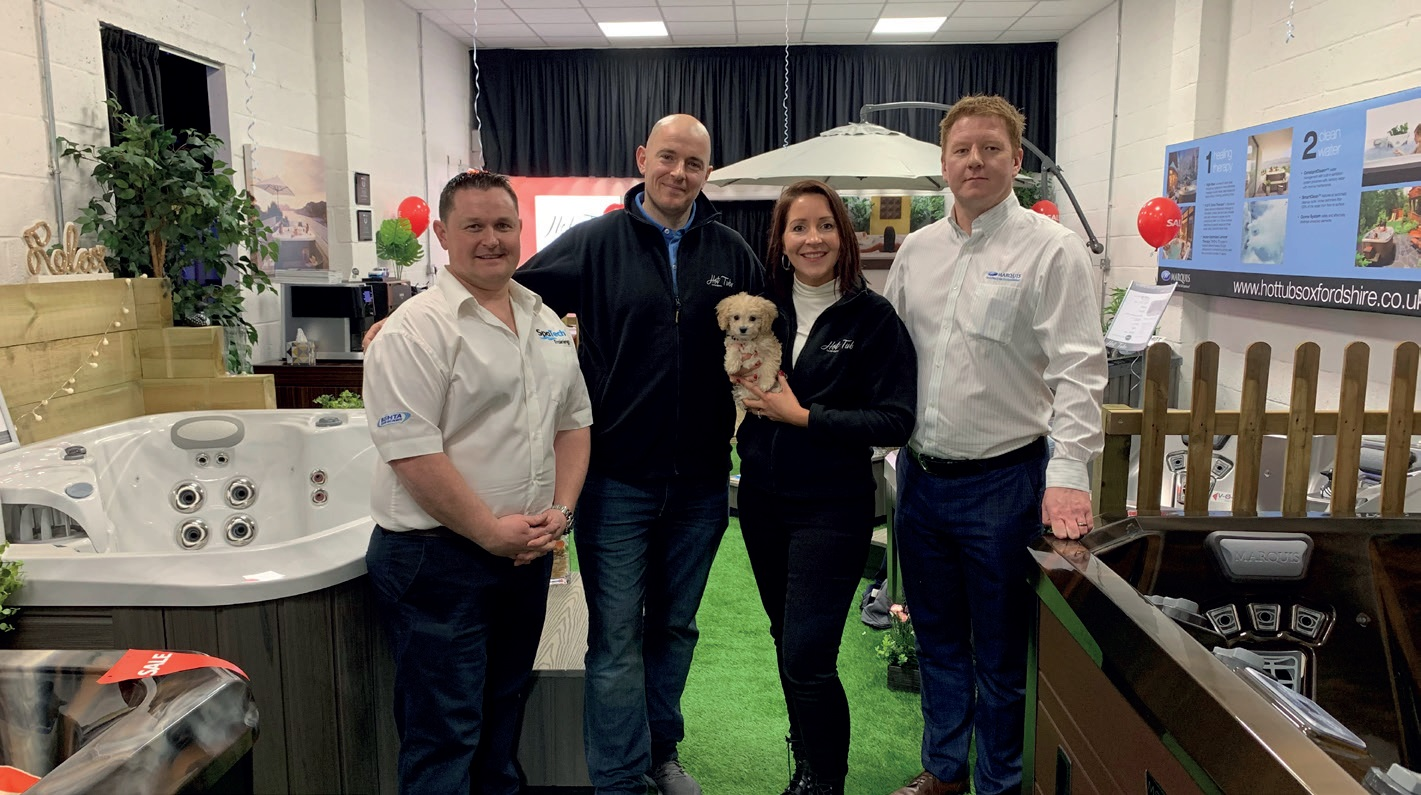KENNY AND CARLA MASSEY, centre, pictured with Chris Brady, left, and Dan Johnson right, at the opening of their new Hot Tubs Oxfordshire showroom.