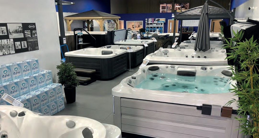 ALL WEATHER LEISURE'S Cannock showroom. Displaying tubs with covers and gazebos help customers to imagine their new purchase in their own home